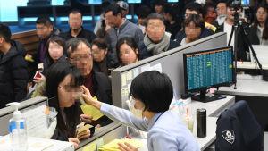 Febern mäts på passagerare från Kina