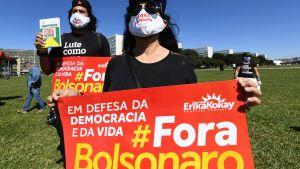 Brasilianska oppositionsaktivister protesterar mot president Jair Bolsonaro i Brasilia 21.5.2020