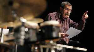 A file picture dated 16 October 2009 shows German Nobel Prize-winning novelist Guenter Grass reading from his book 'Die Blechtrommel', accompanied by a drummer, during Frankfurt book fair in Frankfurt Main, Germany. Goettingen-based publishing house Steid