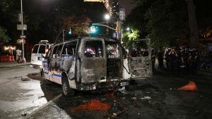Bild på bränd polisbil i New York.