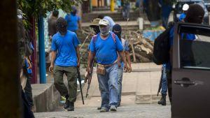 President Ortegas beväpnade anhängare patrullerar gator i Masaya efter att de stormade området och drev tillbaka demonstrerande invånare under blodiga strider.