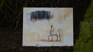 En målning på en kentaur, vid en gran.