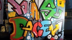 en graffiti med texten näsdagen