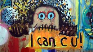 En graffitimålning av en skrämd sagofigur med text på engleska under.