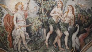 Adam och Eva drivs ut ur paradiset av ängeln med svärd.