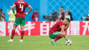 Marockos spelare sörjer över förlust.