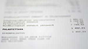 Papper med text och siffror. Dokumentet är ett beskattningsbeslut där mottagaren får besked om skatteåterbäring.
