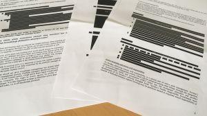 Delvis svärtade dokument från Finansinspektionen