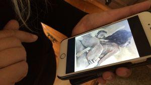 Målning på knullande par i en telefon