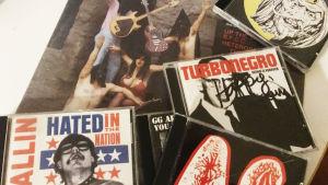Kollage med skivor av GG Allin, The Mentors, Turbonegro och Shitter Limited.