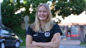 Porträttbild på Ellen Voutilainen.