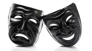 Två ansiktsmasker i svart - en glad och en ledsen.