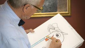 Huck Scarry piirtää lapsille Mato Matalaa.