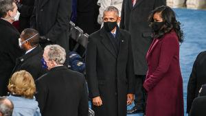 Barack och Michelle Obama till höger.