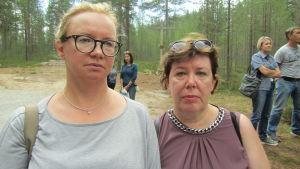 Två kvinnor, Olga Inkilä och Tatjana Kokkonen-Roivas, ser allvarligt in i kameran.