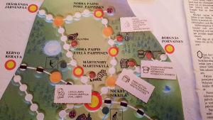 Närbild på spelplanen till brädspelet Sibbo-vargen. På spelplanen har Nickby och olika byar märkts ut.