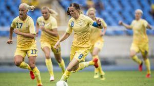 Lotta Schelin och Sveriges damlandslag öppnade OS med seger.