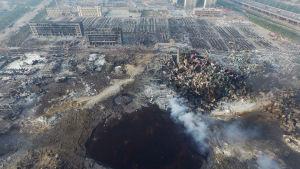 Krater efter explosioner i Tianjin.