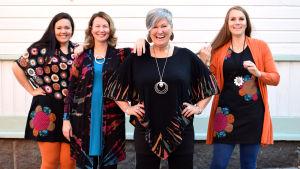 en grupp kvinnor i olika åldrar och storlekar i färgglada kläder