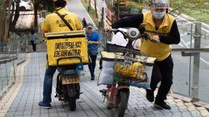 Motorcykelförare i Meituan, Kina.