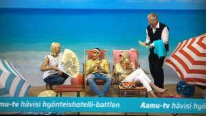 Hyönteishotellikilpailun hävinneen Aamu-tv:n juontajat palvelevat Puoli seitsemän voittajakaksikkoa