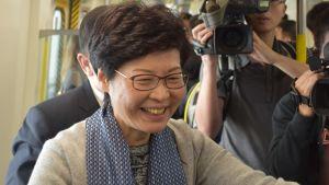 Ledaren Carrie Lam välkomnar megaregionen. Hon beskylls för att vara oförmögen att försvara Hongkongs autonomi.