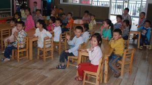 Barn i en fullsatt kinesisk förskola