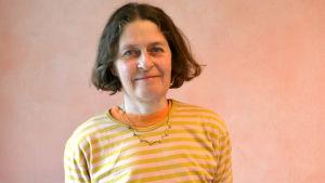 Porträtt av en kvinnlig lärare.