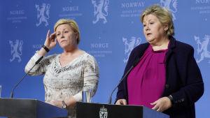 Finansminister Siv Jensen och statsminister Erna Solberg under en presskonferens i Oslo i mars 2019.