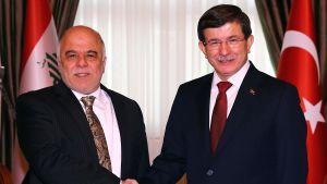 Irak utrikesminister Haider al-Abadi (t.v.) träffade den 25 december 2014 sin turkiske kollega Ahmet Davutoğlu.
