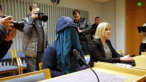 Mannen som dömdes för sexualbrott gömde sitt ansikte i tingsrätten.