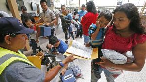 Migranter vid gränsen mellan USA och Mexiko
