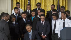 US President Barack Obama, surrounded by students from a Chicago youth guidance program called Becoming A Man, signs a Presidential Memorandum, called the My Brother's Keeper Task Force, in the East Room of the White House in Washington, DC, USA, 27 Febru