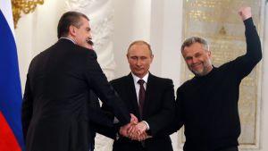 President Putin och ledarna från Krim firar avtalet om anslutning till Ryssland