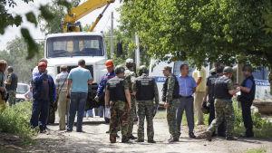 Polis undersöker platsen i Rostov, Ryssland, där en dödades av en ukrainsk granat.