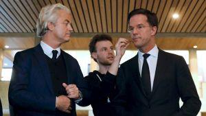 Högerpopulisten Geert Wilders och liberalen Mark Rutte inför en valdebatt.