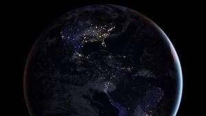 Jorden sedd från rymden under natten.