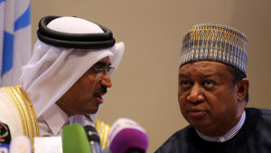 Qatar's Energy Minister Mohammed Saleh Abdulla Al Sada (L) with Secretary General of The Organization of the Petroleum Exporting Countries (OPEC) Muhammed Barkindo (R), during a press conference after informal OPEC ministers meeting in Algiers, Algeria, 2