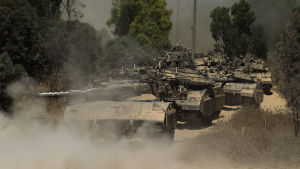 A column of Israeli Merkava tanks moving in southern Israel towards the border with the Gaza Strip, 01 August 2014.