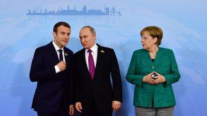 Emmanuel Macron, Valdimir Putin och Angela Merkel på G20-möte