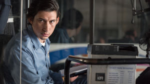 Paterson sitter vid ratten i sin buss.