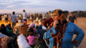 En syrisk flykting vid gränsen mellan Syrien och Turkiet. Turkiet är ett av länderna som öppnat portarna för flest syriska flyktingar.