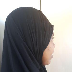 Kvinna med huvudduk
