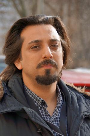 Porträtt på Amir Rostami.