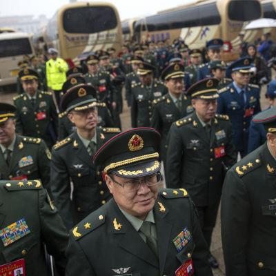 Företrädare för Folkets befrielsearmé på väg till kommunistpartiets 19 nationalkongress hösten 2017.