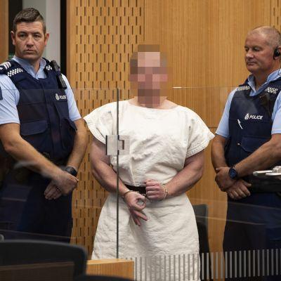 Den 28-årige australiern som åtalas för 51 mord och 40 mordförsök förnekade all skuld i då han deltog i domstolsbehandlingen vida videolänk