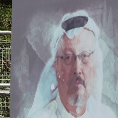 Seinämaalaus Khashoggin kasvoista.