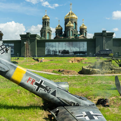 installation of crashed nazzi plane. Russian Army church on the background