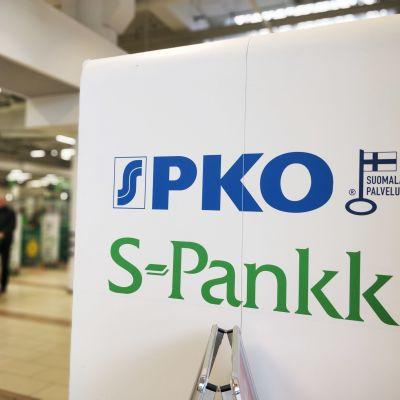 Kuvassa on S-ryhmän PKO:n tunnus.