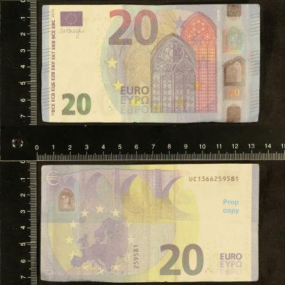Väärennetty 20 setelin raha poliisin kuvassa